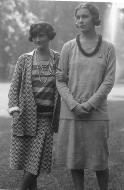 Coco Chanel with Lady Abdy, May 1929 Wearing 3-piece suit with cardigan, pull over, and skirt; patterned jersey fabrics were specifically manufactured for her collections; Courtesy Sandy Black, 2012