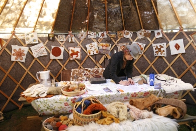 Needle felting activities in Fibershed Yurt, 2013; Photo courtesy David Arelleanes